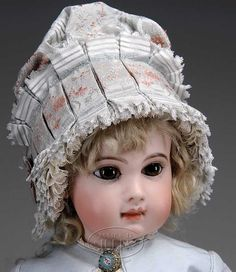 Jumeau Dolls Bebe with trunk. Pale bisque, well defined mouth, and a:
