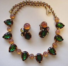 Schiaparelli iridescent amber and dark green glass necklace and earring set