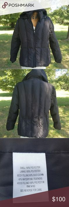 Calvin Klein Hooded Down Coat Black color puffer coat with animal print lining. Excellent condition with detachable amd adjustable hood. 2 outside zipper pockets as well as 3 interior pockets and a card holder pocket. Down filling in body consists of goose down as well as waterfowl feathers and additional filling is polyester. Offers considered. No trades. Calvin Klein Jackets & Coats Puffers