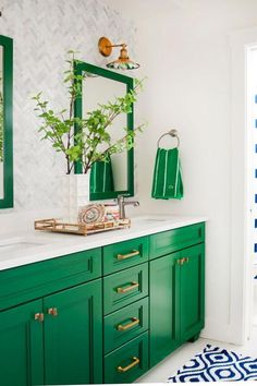 Green and Neutral Bathroom with Mirrors, Patterned Wallpaper and Blue-and-White . Green and Neutral Bathroom with Mirrors, Patterned Wallpaper and Blue-and-White Rug # Decor, Green Vanity, Interior, Green Bathroom, Green Cabinets, Bathroom Trends, Home Remodeling, House Interior, Blue And White Rug