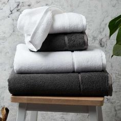 Beautiful eco-friendly bathroom towels which are made from a combination of organically grown bamboo and bombed long-staple cotton. These sustainable bamboo towels are available in two colours, pure white & urban grey. Best Pillow, Perfect Pillow, Brown Glass Bottles, Comfortable Pillows, Bath Sheets, Bathroom Towels, Image House, Pure White, Metallic Leather