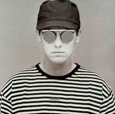 Chris Lowe circa 1986. Sunglasses by Issey Miyake. Photography by Eric Watson.