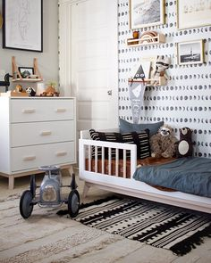 SPOTTED on The other side of shared nursery + toddler room is so dreamy. It's masculine, playful and still vibes with the entire room. TAP for deets on this darling space.