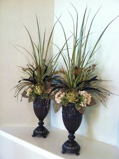 Traditional, Tall, Faux Artichoke & Hydrangea Floral Arrangements made in beautiful containers. Perfect to flank a mirror or tv on a mantel. Can even use on a sideboard or sofa table. By Greatwood Floral Designs.