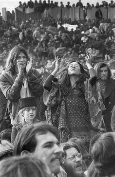 Concert-goers of all ages stand and sway to the music during the free Altamont Rock Concert on Dec. 6, 1969. More than 200,000 music fans crowded the hillsides, and four people were reported to have died.