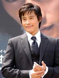 lee in black suit & black tie