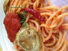 Spaghetti with fresh tomato sauce and fried  organic zucchini in Sicily.