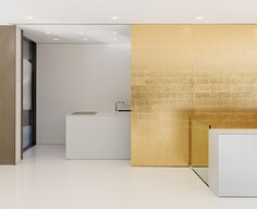 Cool German house has golden sliding wall that reveals a hidden kitchen