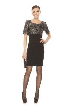 Metallic on top, short sleeves and black on the bottom makes this dress very sleek!  Just arrived at Dressed by Lori!