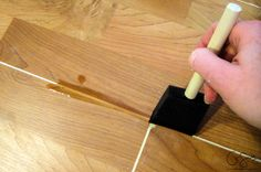 How to patch gaps in laminate floors when you have removed a wall or want to join two sections of laminate flooring together and can't snap together. laminate floors ideas Patch Gaps in Laminate Floors Laminate Flooring Fix, Laminate Floor Repair, Painting Laminate Floors, Flooring On Walls, Laminate Wall, Diy Flooring, Plank Flooring, Kitchen Flooring, Flooring Ideas