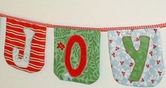 Take one charm pack of 5″ squares, a string of ribbon and an hour of your time to create this colorful bunting.  Shown here in Christmas fabrics this bunting isn't just for Christmas. Depending on your fabric choices it would look good at a wedding, christening, halloween, birthday, July 4th. In fact the occasions are endless.