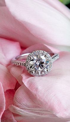Love this dazzling halo diamond ring with an antique feel.