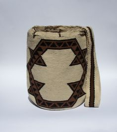 Hi, my name is Cosmica, I represent the earthy colours of the native land, La Guajira, Colombia. Beautiful handmade shoulder bag.  Sydney clothing trends. www.thewayucollection.com