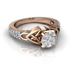 14k Rose Gold White Diamond Engagement Ring - The ring holds symbolism in its design with its Celtic knot & 20 diamonds. The curvy lines represents everlasting love. The center gemstone is an elegant round stone & around the band lie twenty dazzling diamonds. This ring creates the illusion of a large diamond. 7 diamonds are set into 14K gold with a carat weight of 0.21. The band is 1/4 of an inch tapering to 1/8 of an inch at the back & is 1/4 of an inch off the finger…