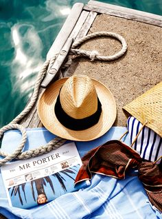 If not a beach picnic, then maybe something poolside. Overhead shot—hats, pool snacks, sunscreen.