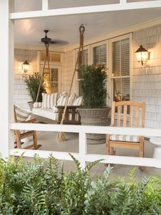 Porch Swing ~ tall planters, wall sconses ~ Rebecca Gardner PalmettoBluff
