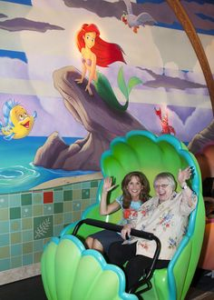 Jodi Benson and Pat Carroll, the voices of Ariel and Ursula in The Little Mermaid, riding Ariel's Undersea Adventure at Disneyland.