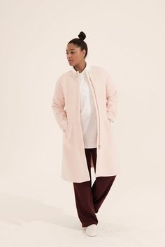 pale pink coat Stories, white shirt Marks and Spencer, maroon track pants H &M, white trainers