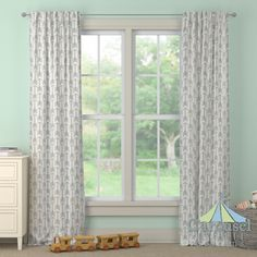 Custom drapes in White and Gray Arrow.  Created using the Drape Designer by Carousel Designs