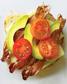 Holy deliciousness...cheddar, dijon mustard, bacon, tomatoes, and avocado grilled cheese sandwich!!