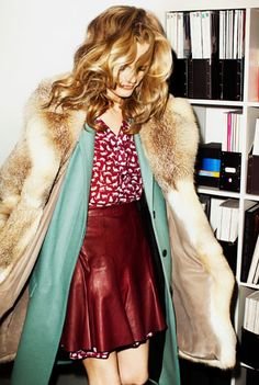 Wowza. Everything is complete with this outfit. Burgundy leather skirt. Mint jacket. Fur coat.