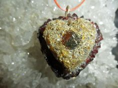 100% Amber Stone, that has a Amber Heart and with Garnet Gemstone Charm