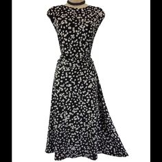 """Size 3X Sexy Black & White GODDESS DRESS Plus Size This sexy, flattering black & white dress is perfect for Spring & Summer!   Size: 3X Slip on/ slip off Sleeveless Black & White speckled print Buttery-soft, stretchy fabric Flattering ruched waist Measurements: Bust (armpit to armpit):  54"""" relaxed - stretches to 66"""" Waist: 47.5"""" Hips:  60"""" relaxed Length: 44.5"""" (top of shoulder to bottom hem)  Condition:  PRISTINE CONDITION! Fabric Content: 95% Polyester  5% Spandex   Fabric Care:  Machine…"""
