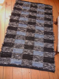 """Black, Gray, and Light Blue Wool Handwoven Rug In Checkerboard Design The rug measures 46.5"""" x 28"""""""