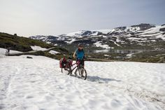 When it's hot, find snow on Rallarvegen - between Haugastøl and Flåm (with stops at for example Finse, Hallingskeid and Myrdal).