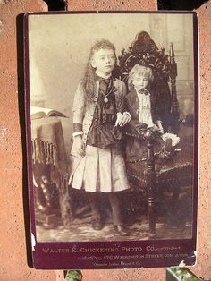 Little girl with big doll by hliguy, via Flickr