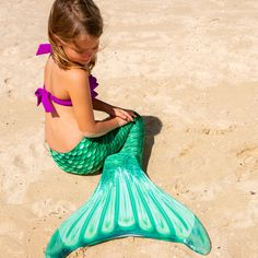 Capture that classic mermaid look with Fin Fun's Celtic Green mermaid tail! Our refreshed pattern features bubbly scales of mint and bright green printed on premium fabric. · Reinforced Tips Prevent Holes · Tail Tip Warranty · Machine Washable