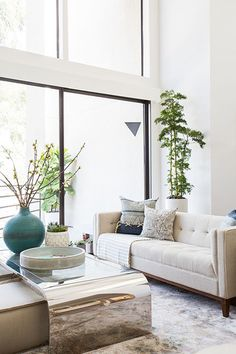 The crisp white walls and windows let in ample light, which is only brightened by the condo's cool-toned color palette.