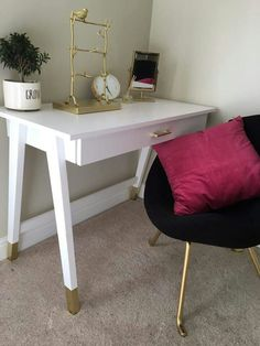 Cute sleek and classy white small desk with gold dipped legs and gold drawer pull....