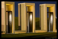 Bonfire Memorial on the Texas A Campus, view of three individual memorial, at night.