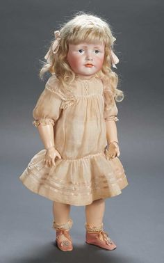 "Beautiful German Bisque Art Character Doll  18"" (46 cm.) Marks: K*R 114 246. Comments: Kammer and Reinhardt,circa 1919,from the firm's art character reform series,this model marketed as ""Gretchen"". Value Points: especially fine quality of sculpting with well-defined facial planes,fine luminous bisque."