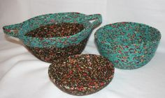 Coiled fabric bowls.