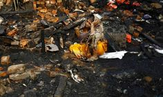 <strong>Kolkata , India</strong> Taramuni Ray, cries as she sits on the debris from her burnt hut after a fire at the slum where she lives