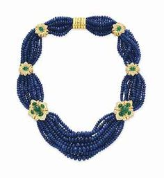 A SAPPHIRE BEAD, DIAMOND AND EMERALD NECKLACE Designed as multiple strands of sapphire beads, spaced by a graduated series of circular-cut diamond and cabochon emerald sculpted plaques, mounted in 18k gold.