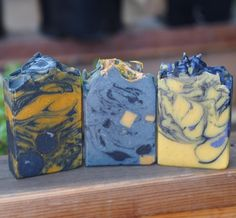 """Halloween Soaps! From L-R:  """"Hallows Eve"""" Vanilla Cinnamon and Benzoin essential oils and absolutes. Smells good enough to eat! Bamboo Charcoal Annatto Seeds and Vanilla Beans for color and texture.  """"Nightfall"""" A very unique scent! Sweet smokey and minty. Peppermint Benzoin and Birch Tar essential oils and absolutes. Bamboo Charcoal for color and chunks of Pumpkin Spice soap for contrast.  """" Witches Brew"""" Cedarwood and Orange essential oils. Pumpkin flesh Nutmeg powder Dragons Blood Resin…"""