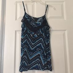 Cute flowy spaghetti top Cute pattern and perfect for the summer. Different tones of blue with white and black hints. Spaghetti straps on the top. Only worn once. Self Esteem Tops Blouses