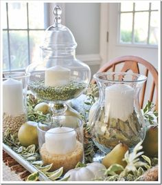 wedding centerpieces..love the different apothecary jars.. notice the different textures