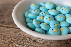 M blue birds.  Would look adorable on a bird's nest cupcake.