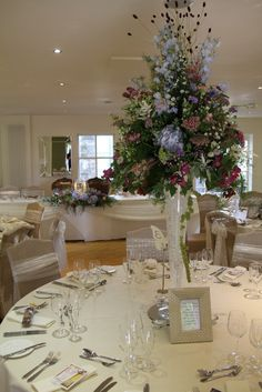 Flower Design Events: A tall elegant table design of wild grasses and flowers
