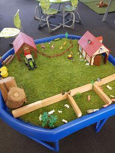 Farm themed tuff tray using fake grass cut to shape and farm animals