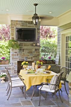 Love the brick outdoor fireplace on a covered patio.  And must have a fan!