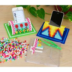 Everyone can use a colorful cell phone stand to play music while you work or study. Choose from a garden or super-hero design, created by Kyle McCoy.
