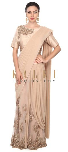 Buy this Beige saree gown adorn in pearl and sequin embroidery only on Kalki