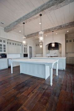 Home Remodeling Wood I love the idea of extending an island like this. But don't like the table legs, I'd like big wood beams Farmhouse kitchen. Rustic Kitchen, New Kitchen, Kitchen Decor, Kitchen White, Kitchen Ideas, Kitchen Layout, Awesome Kitchen, Kitchen Storage, Double Island Kitchen