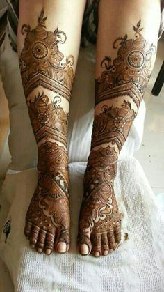 Bridal intricate leg mehendi or henna designs.