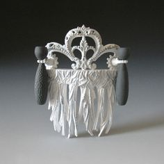 Tamara Grüner  Brooch: Evercomb 2011  Historical metal pressing, plastic, black porcelain, silver, paint, steel  13,0 x 10,6 x 2,8 cm
